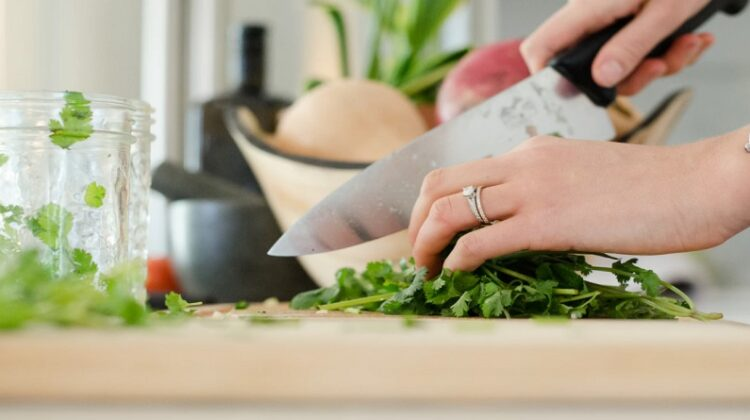 Hands chopping parsley - Meal Prepping Made Easy