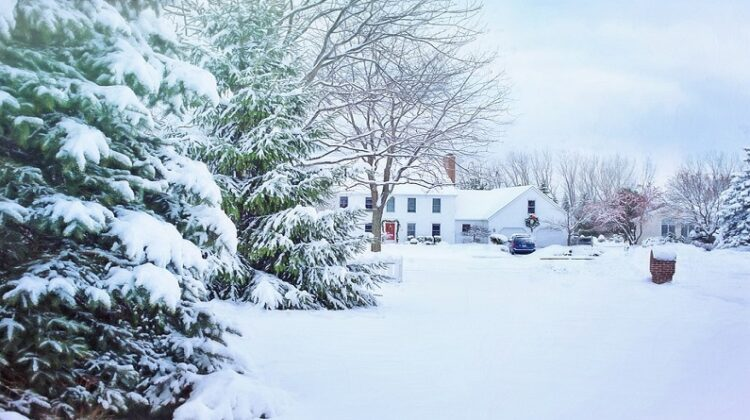 Winter landscape with home in lots of snow - Essential Repairs For Your Home This Winter