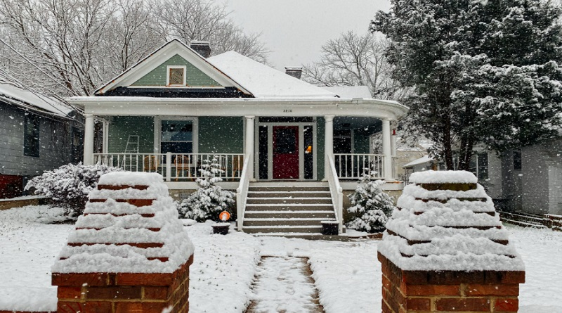 Single Story Home with Snow on Roof and Yard