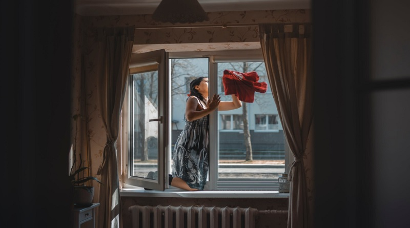 Woman Cleaning her Windows - How to Clean Windows