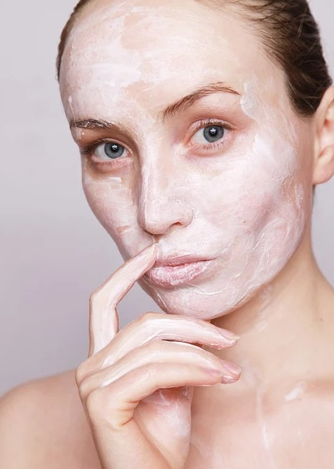 Woman with cream on her face - Enhance Your Natural Beauty