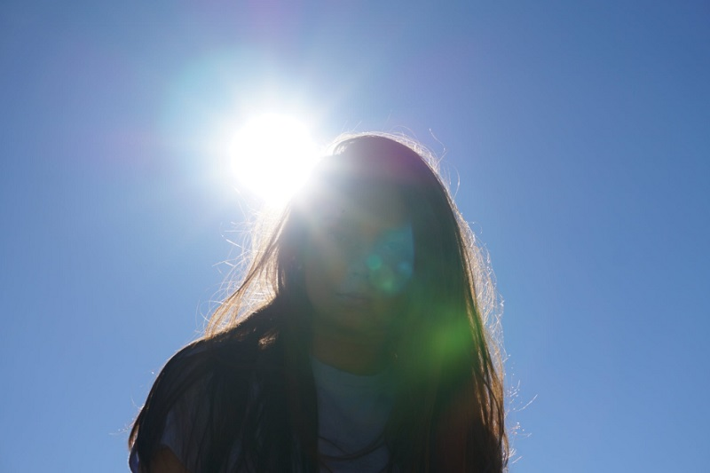 Woman with the sun shining behind her - Can Your Home Give You Healthier Skin