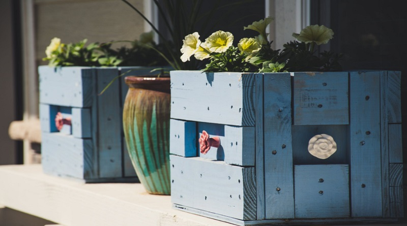 Blue Decorative Boxes Holding Flowering Plants Simple Ways To Make Your Home Look Better
