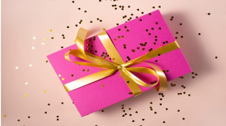Box Wrapped in Bright Pink Paper and Tied with a Gold Ribbon