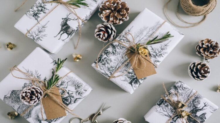 Christmas Gifts Wrapped in Winter Wildlife Paper with Pine-cones and Greenery Eco-Conscious Holiday Gift Ideas