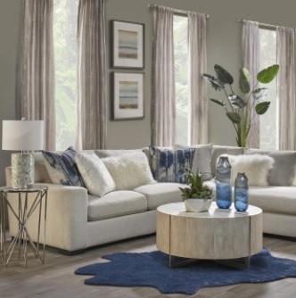 Living Room with Mongolian Pillows and Blue Accents Create a Chic Décor