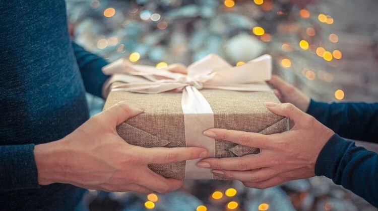 Man and Woman's Hands Holding Wrapped Package Perfect Gifts for the Man in Your Life