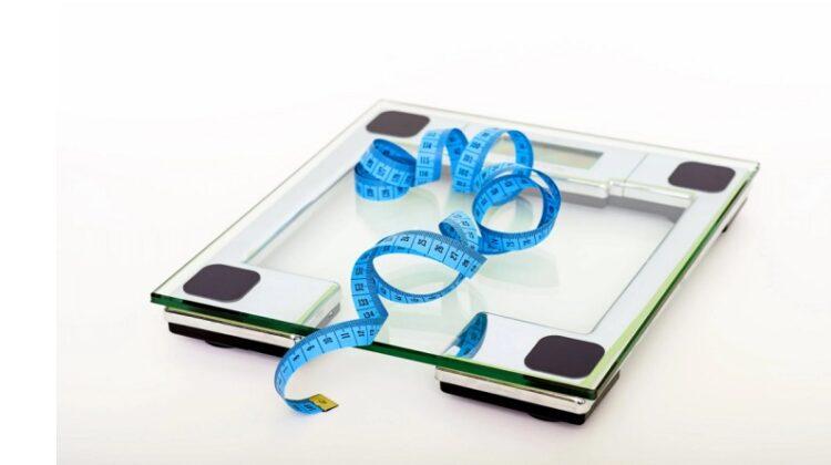 Scale and Measuring Tape Lose Stubborn Body Fat