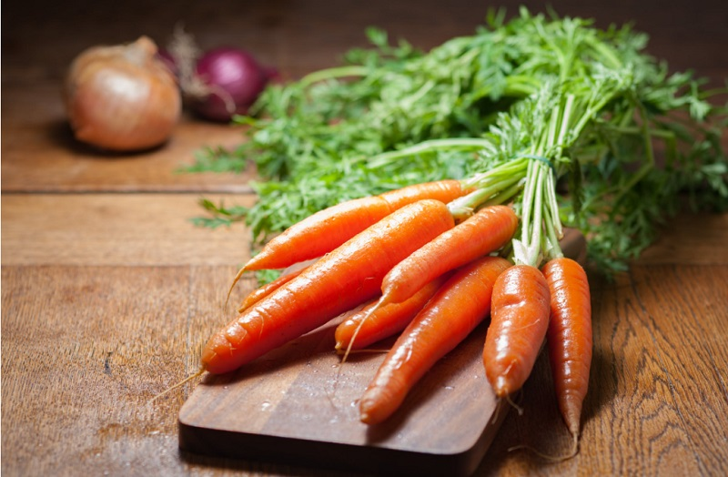 Foods That Can Benefit Lung Cancer Patients Carrots on a cutting board