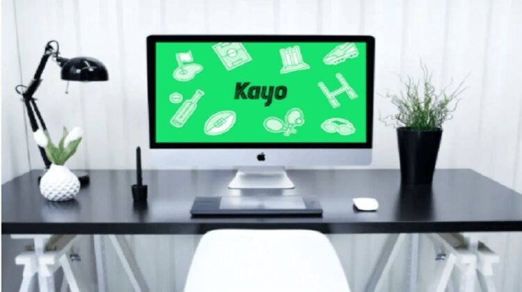 Desk with Kayo Sports on Computer Screen