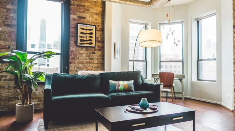 Creating a Healthier Home Living room with exposed brick and lots of windows
