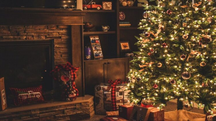 Getting Your Home in Top Condition for the Holidays Living room with fireplace an decorated Christmas Tree