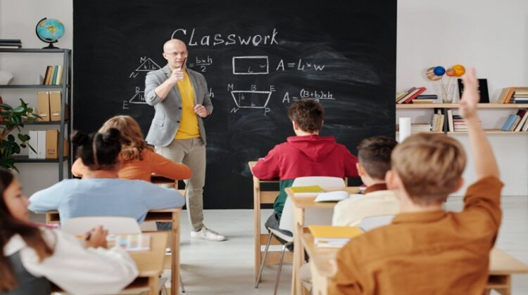 Dangers of Working as a Teacher Teacher at Chalkboard in Small Bright Classroom