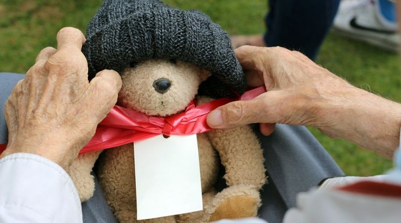 Retirement Gift Ideas Teddy Bear on Older Person's Lap