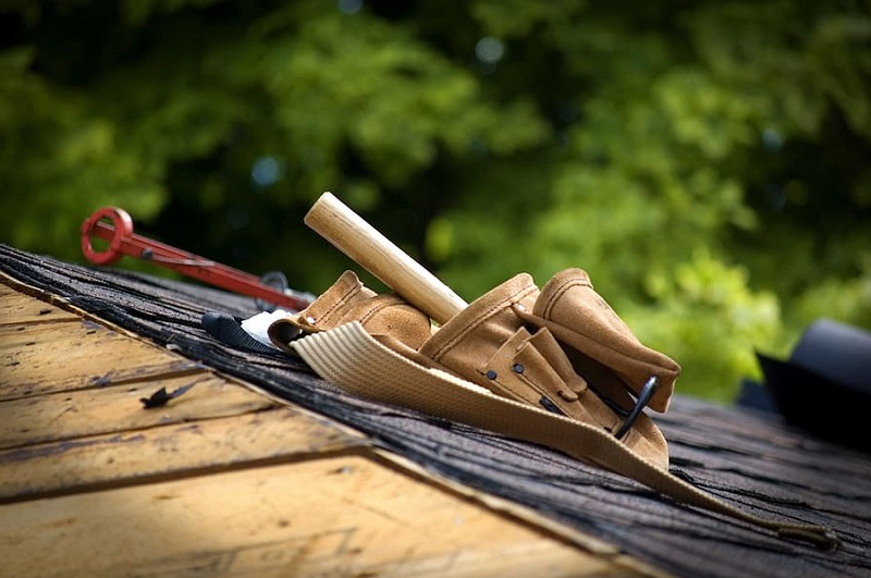Tool Belt on Roof under Construction Why You Need To Hire A California Metal Roofer