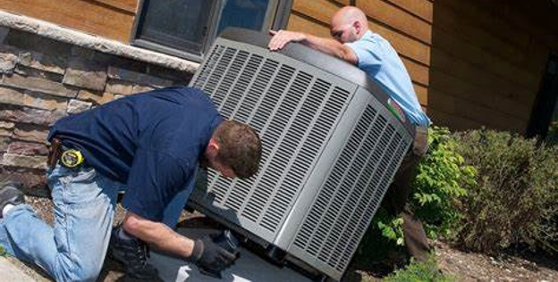 Air Conditioning Installation 2 Men Installing an HVAC Unit