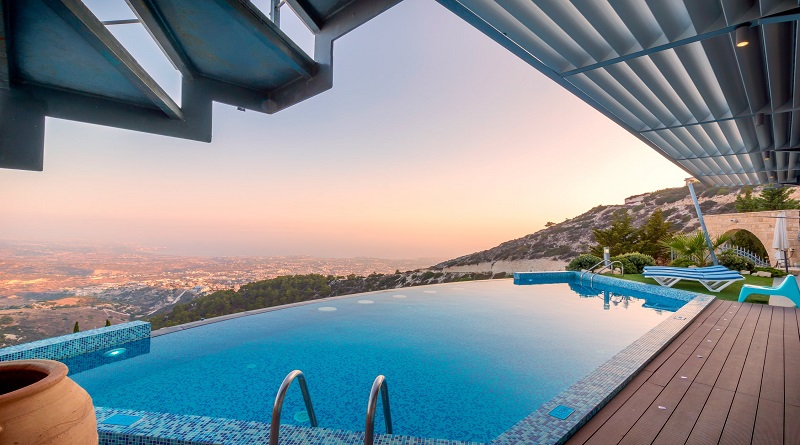 Adding These Unique Selling Points To Your Home Beautiful pool overlooking a city in the valley