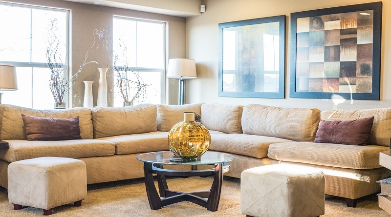 Create the Most Comfortable Living Room Cozy Neutral Living Room with Secitonal Soafa and Bold Artwork on the Walls