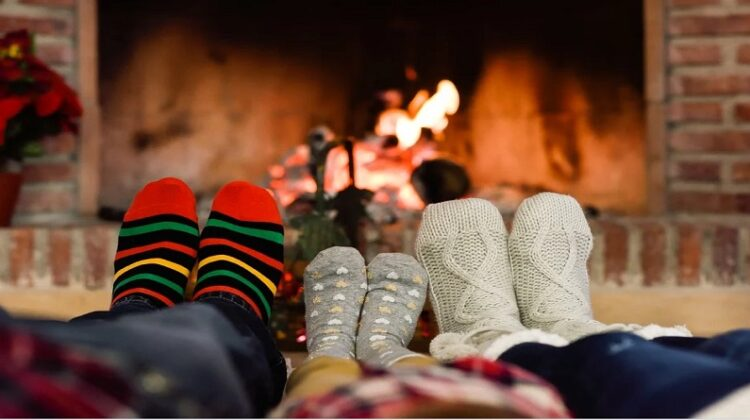 Create a More Comfortable Environment Family in Socks sitting in front of a fire
