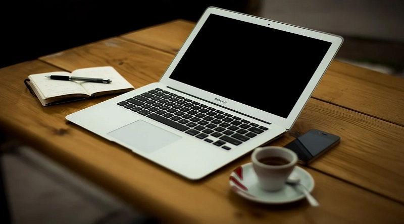 Interior Design Choices When Working From Home Laptop on Wooden table with coffee cup and cell phone