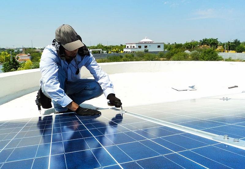 Maintaining Your Solar Panels Man Repairing a Solar Panel