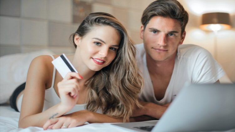 Things To Consider Before Buying A Home Young couple making purchase from home via the internet