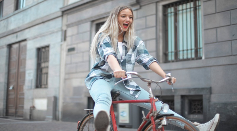 Different Types of Bikes Woman in Plaid Shirt and Jeans, on Red Bike