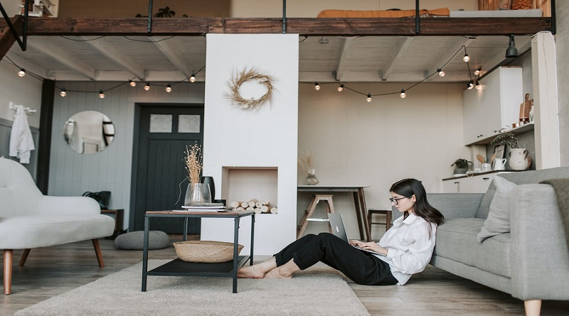 VPN Services Woman sitting on living room floor using laptop