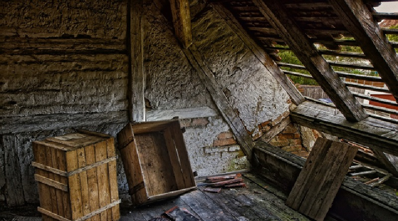 Attic with damaged roof Asbestos Removal