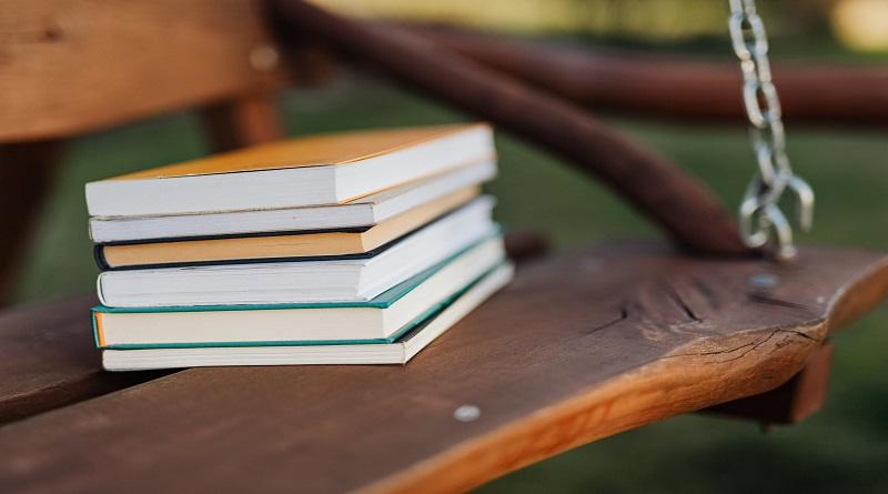 Chairs for Outdoor Activities Large Wooden Swing with Stack of Books