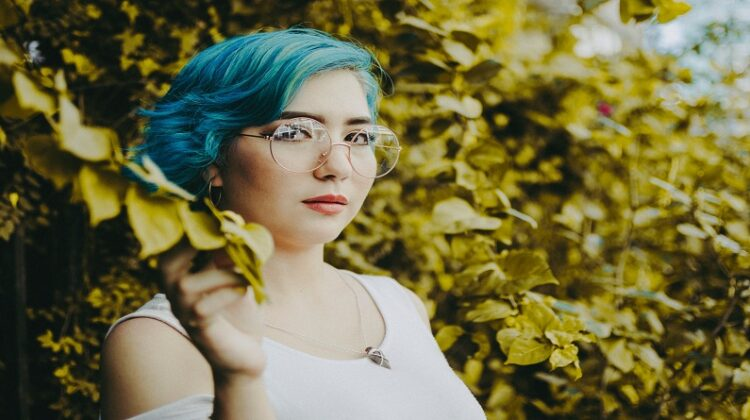 DIY Your Hair Color Woman wearing glasses with blue hair
