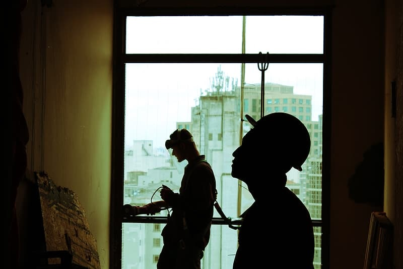 Benefits of Building Inspections two-men-wearing-hard-hats-standing-near-clear-glass-window