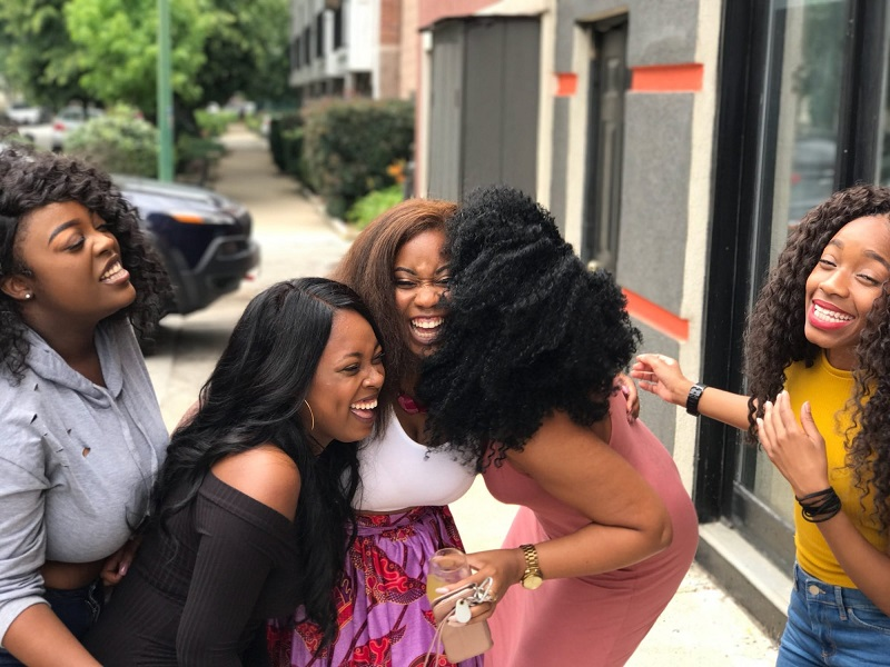 5 Women Smiling and Laughing Together