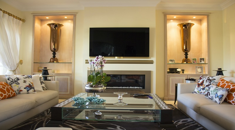 Spruce Up Your Home Living Room with Two Sofas, Glass Coffee Table, Large Rug and Fireplace with Flat Screen TV