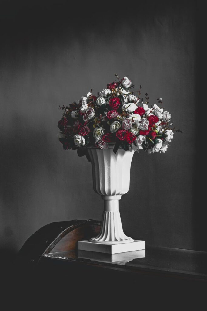 Ideas for a Gorgeous Anniversary Floral Arrangements Red Roses with White Accent Flowers in Large White Urn