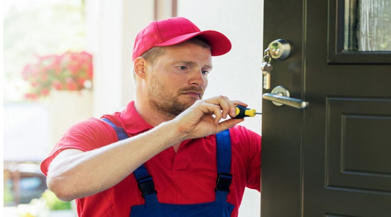 5 Tools Every Locksmith Should Have Locksmith working on a door