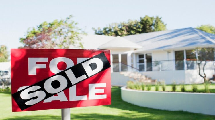 Sold sign in front of home Factors Influencing a Customer's Home Buying Decision