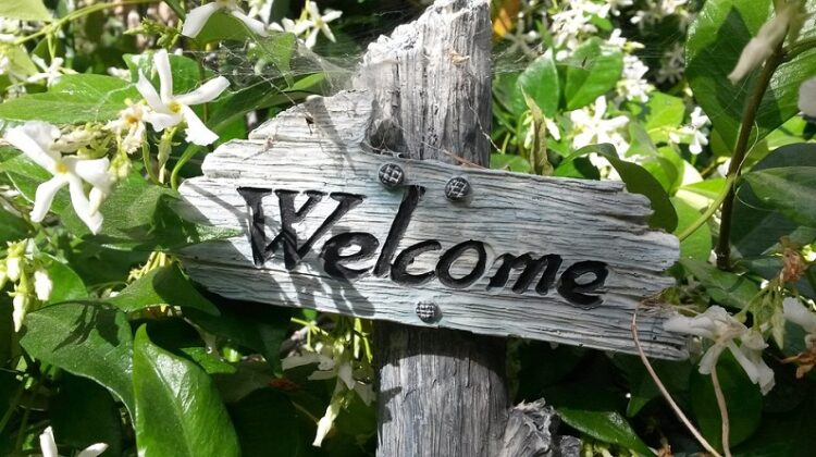 Garden Upgrades Made Easy Welcome sign in garden