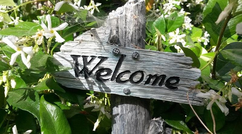 Garden Upgrades Made Easy Welcome sign in garden
