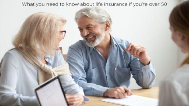Couple signing papers What you need to know about life insurance if you're over 50