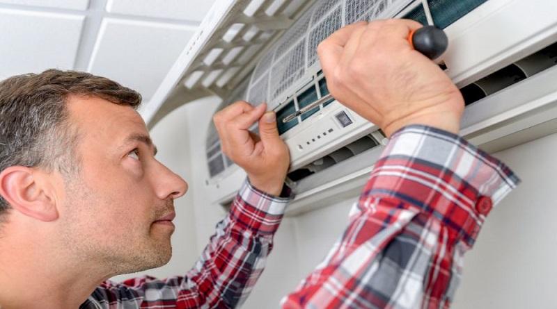 AC Repairman working on HVAC Split Unit