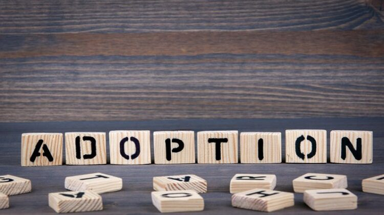 Adopting a Child Adoption spelled out in small wood tiles