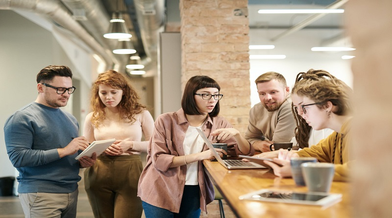 Give Back to Your Employees Employees working together in office