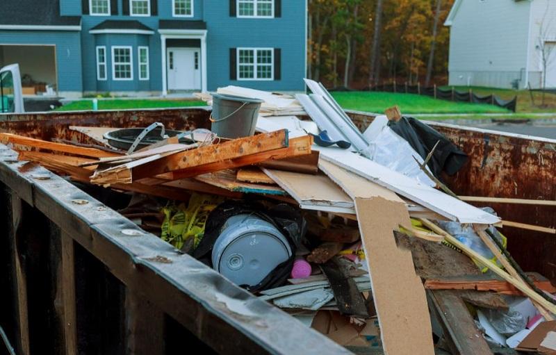 Full dumpster outside of home Dumpster Rental vs Dump Truck