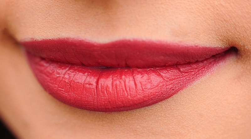 Lip Lift or Lip Fillers Smiling lips with red lipstick