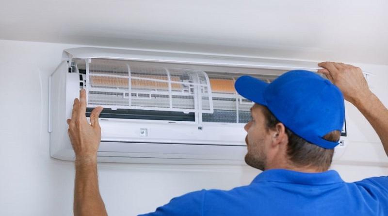 HVAC Contractors Technician working on HVAC Split Unit