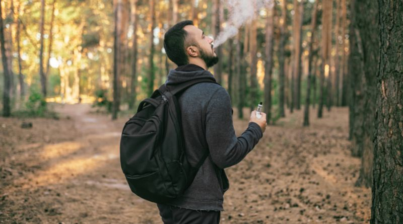 Buying Vape Juice Online Bearded man with backpack vaping in the woods