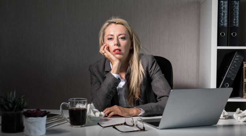 Benefits Of Doing a Job That You Love Bored woman sitting at her desk at work