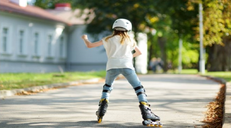Get Your Child More Active Outdoors Little girl rollerblading in the park