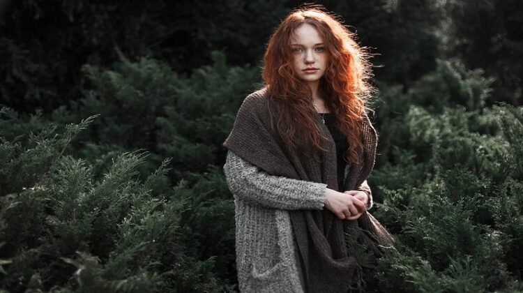 More Responsible In Your Style Lovely redhead in grey sweater, in nature
